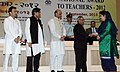 Pranab Mukherjee presenting the National Award for Teachers-2012 to Smt. Waheeda Chowdhary, Jammu & Kashmir, on the occasion of the 'Teachers Day', in New Delhi. The Union Minister for Human Resource Development.jpg