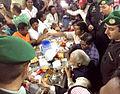 Prime Minister Narendra Modi shares snacks with L&T workers in Saudi Arabia.jpg