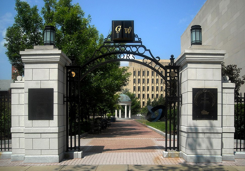 """Open gateway with the letters G and W and the phrase """"Professors Gate"""" visible on the arch"""