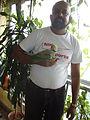Psittacula eupatria -Rudolph A. Furtado holding his parrot-6a.jpg