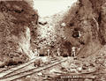 Queensland State Archives 2322 Four miners at face of cutting Mount Morgan 1897.png