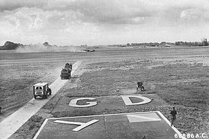 """RAF Great Dunmow - The B-26 Marauder named """"Carefree Carolyn"""" from the 386th Bomb Group comes in for a wheels-up landing after completing its 100th mission on 15 June 1944."""