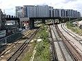 Railway lines and Chelsea Bridge Wharf apartments from Battersea Park Road, London SW8.jpg