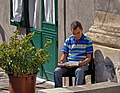 Reading a newspaper. Catania, Italy (cropped).jpg