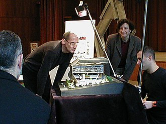 Seattle Central Library - Architect Rem Koolhaas inspecting a model of the building. Joshua Prince-Ramus is kneeling.