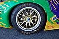 Rohr Porsche 911 GT1 Right rear tire, wheel, brake, center-lock nut with shipping loop, engine cover fender (6305876325).jpg