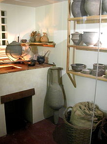 Kitchen corner, with pottery and basket