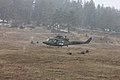 Romanian soldiers with the 20th Infantry Battalion provide security as a Slovenian army UH-1N Iroquois helicopter lands during a mission rehearsal exercise (MRE) March 18, 2013, at the Joint Multinational 130318-A-IR813-006.jpg