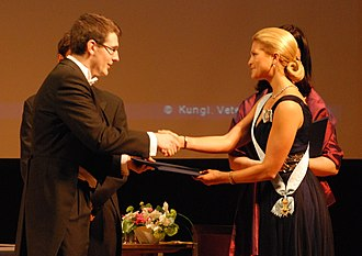 Princess Madeleine, Duchess of Hälsingland and Gästrikland - Madeleine handing the Göran Gustafsson Prize to Johan Elf in 2010.