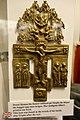 Russian orthodox crucifix w relief icon (cast metal brass cross) found in wreck of WW2 German Navy Kriegsmarine battleship Tirpitz sunk outside Tromsø, Norway 1944. Lofoten Krigsminnemuseum 2019 DSC00337.jpg