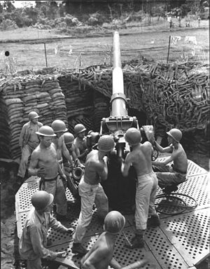 3-inch Gun M1918 - Gun crew man their 3-inch M3 at New Fighter Strip, Dobodura, New Guinea.