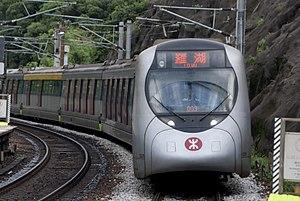 SP1900 EMU - SP1900 trainset E215/E213 on East Rail Line entering University Station platform 1