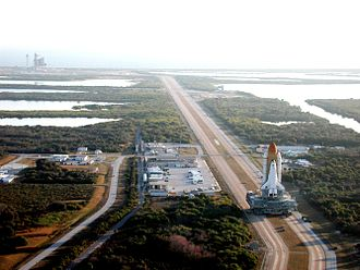 STS-98 - A Crawler-Transporter ferrying Space Shuttle Atlantis to launch pad 39-A for the STS-98 mission.