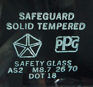 Toughened glass - Safety approval markings on an automobile vent window made for a Chrysler car by PPG.