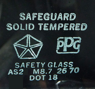 Tempered glass - Safety approval markings on an automobile vent window made for a Chrysler car by PPG.