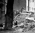 Sarajevo siege man and garbage.jpg
