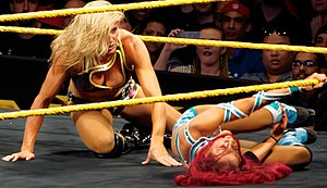 Sasha Banks - Banks wrestling Charlotte during a house show in March 2015