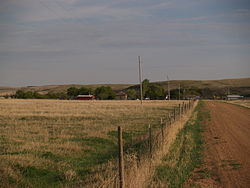 Fenceline allow a road in Schafer