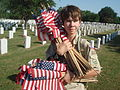 Scouts salute Fort Sam Houston Cemetery with flags of honor.jpg