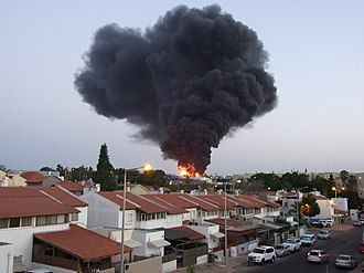 2014 Israel–Gaza conflict - Factory bursts in flames after rocket attack in Sderot, Israel, 28 June 2014