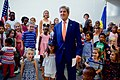 Secretary Kerry Hugs a Child Wearing a Boston Red Sox Hat After Arriving to Greet U.S. Embassy Kigali Staff and Family Members (30240818631).jpg