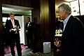 Secretary of State John Kerry, left, surprises Secretary of Defense Chuck Hagel, right, with a birthday cake in honor of Hagel's Oct. 4 birthday in Tokyo Oct. 3, 2013 131003-D-BW835-1979.jpg