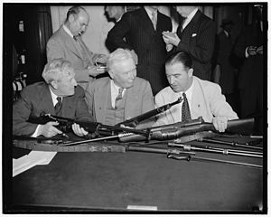 M1941 Johnson rifle - Senator Morris Sheppard, left, Chairman of the Senate Military Affairs Committee, Maj. Gen. George A. Lynch, U.S. Chief of Infantry, and Senator A.B. Chandler of Kentucky, inspect the M1941 semi-automatic rifle which competed to replace the M1 gas-operated rifle as the Army's standard shoulder weapon.