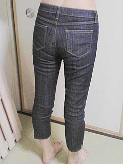 Slim-fit pants jeans or other trousers tailored to fit very close to the body, especially through the legs