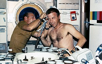 Paul J. Weitz - Skylab 2 Commander Pete Conrad trims Weitz's hair in Skylab's crew quarters