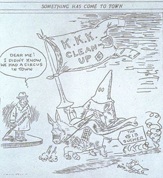 Ku Klux Klan in Canada - A political cartoon published by the Manitoba Free Press on 25 October 1928. Attempts by the Ku Klux Klan to expand into Manitoba were not successful.