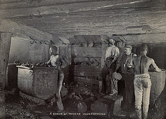 Koffiefontein mine - A group of miners working underground mines of the Kimberlite Pipes