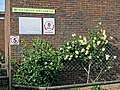 Southgate Adelaide Cricket Club sign and rose bed at Walker Cricket Ground pavilion, Southgate, London, England.jpg