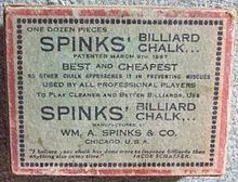 "Image: A faded white cardboard box, about 3 by 4 by 1 inches, with a red border and a lot of black text, reading ""One dozen pieces SPINKS' BILLIARD CHALK"" and various promotional slogans such as ""BEST and CHEAPEST"", and ""USED BY ALL PROFESSIONAL PLAYERS"", among other lines, some indistinct."