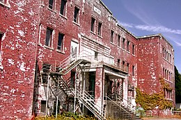 Exterior view of dilapitated St. Michael's Residential School in Alert Bay, British Columbia.