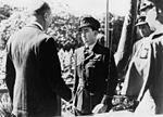 StateLibQld 2 185007 Flying Officer Keith Noel Heilbronn being decorated by the Governor General, Henry, Duke of Gloucester, in 1945.jpg