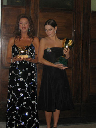 Giovanna Mezzogiorno - Mezzogiorno (right) along with Stefania Sandrelli shows off her Coppa Volpi