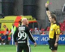 Stig Tøfting takes a yellow card (2007).jpg