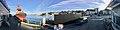 Stord harbour (hamn), Leirvik, Norway. BB COASTER (tug boat, Brevik, 2008), Leirvik terminal by Fylkesveg 544, Thiisafabrikken,.Distorted, compressed panorama 2018-03-10.jpg