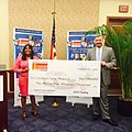 Terri Sewell accepting check from Hyandai for childhood cancer research.jpg