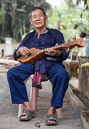 Lu people - Image: Thai Lue musician at Wat Nong Bua 01