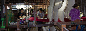 Thai silk - Operating a traditional hand loom, Surin