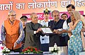 The President, Shri Pranab Mukherjee distributing the keys and ownership certificates for EWS houses built under the Integrated Housing & Slum Development Project, at Jiwaji University, in Gwalior.jpg