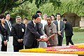 The Prime Minister of Japan, Mr. Shinzo Abe paying floral tributes at the Samadhi of Mahatma Gandhi at Rajghat, in Delhi on August 22, 2007.jpg