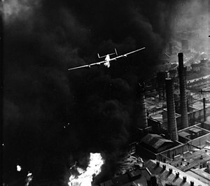 """The Sandman"", a B-24 Liberator, emerging from smoke over the Astra Română refinery, Ploiești, during Operation ""Tidal Wave"" (1 August 1943)"