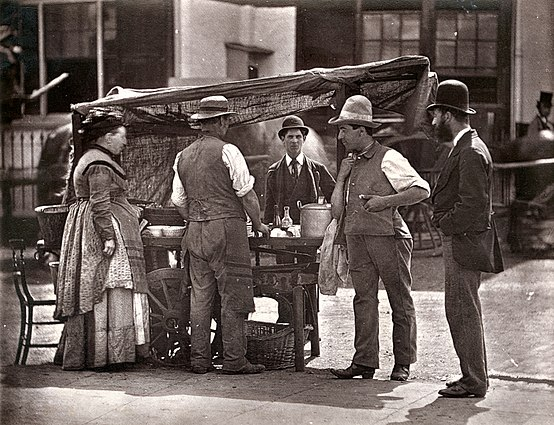 A street stall in London during the 1870s The Sellers of Shell-fish (6924988264).jpg