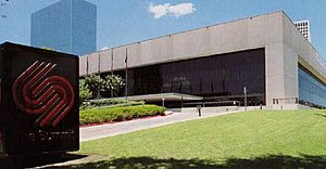 Lakewood Church Central Campus - The Summit stands among the high-rise office buildings of Greenway Plaza, c. 1994