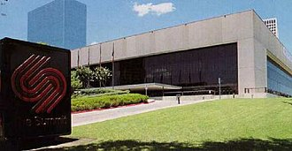 Lakewood Church Central Campus - The Summit stands among the high-rise office buildings of Greenway Plaza, c. 1994.