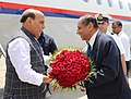 The Union Home Minister, Shri Rajnath Singh being received by the Governor of Andhra Pradesh and Telangana, Shri E.S.L. Narasimhan, on his arrival, in Hyderabad on April 10, 2018.jpg