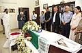 The Vice President, Shri M. Hamid Ansari paying homage at the mortal remains of the former Lok Sabha Speaker, Shri P.A. Sangma, in New Delhi.jpg