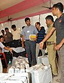 The polling officials checking the Electronic Voting Machines (EVM's) required for the General Elections-2014, at a distribution centre, at Patna, Bihar on April 16, 2014.jpg